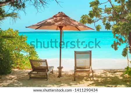 Two beach chairs on tropical vacation at sea #1411290434