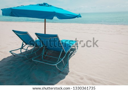 Two beach chairs on tropical vacation, vacation concept