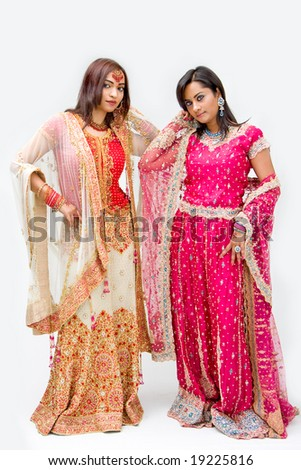 Two beautiful Bangali brides in colorful dresses, isolated