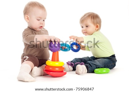 two beautiful children playing with pyramide - stock photo