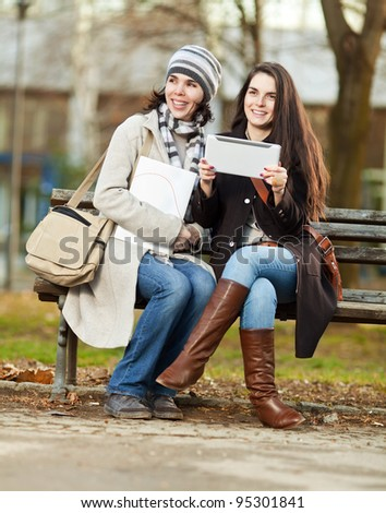 Two beautiful female students outdoors