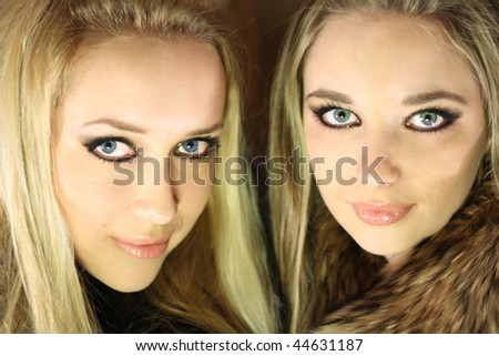two beautiful girl brunette and blond with long hair
