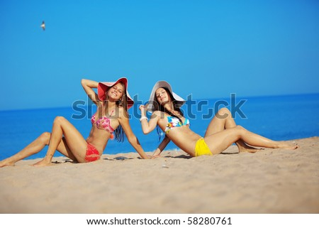 Two beautiful girls at beach