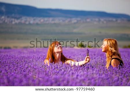 Two beautiful girls in lavender meadow