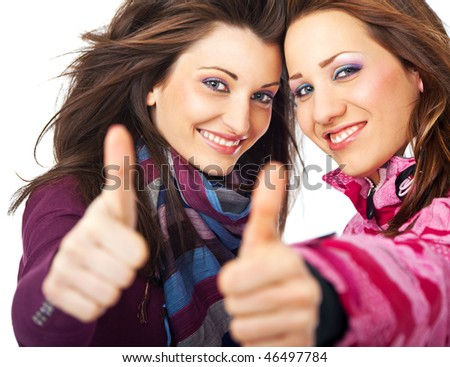 two beautiful girls smiling and showing thumbs up