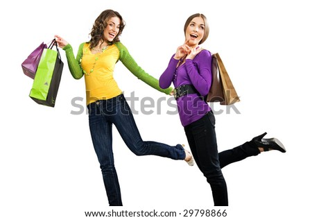 Two beautiful girls with shoppingbags isolated on white