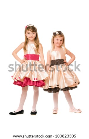 Two beautiful little girls in a dress. Isolated