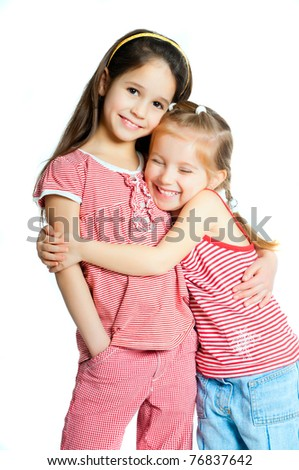 stock photo : two beautiful little girls on a white background