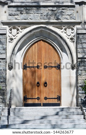 Two beautiful oak doors at the entrance to a church