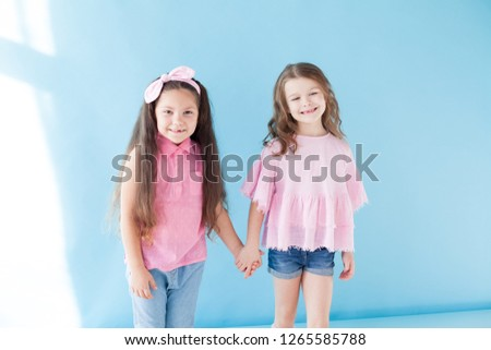two beautiful small girls girlfriend sister in pink clothes