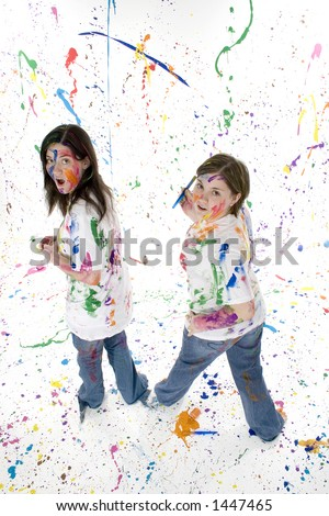 Two beautiful teen girls covered in paint with a \