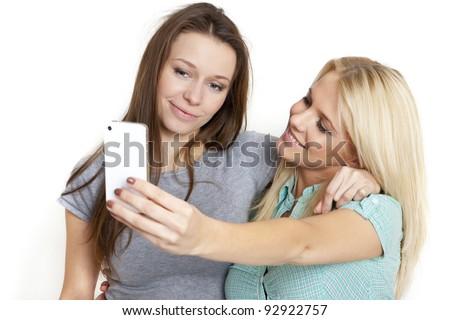 two beautiful woman  taking photo  a smart phone