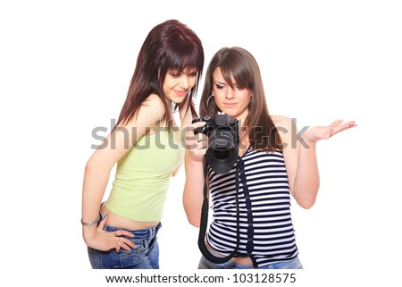 two beautiful woman taking photos with a DSLR camera