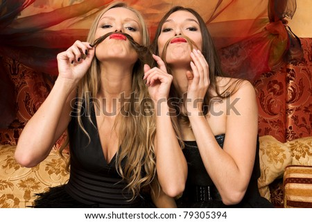 Two beautiful women are having fun
