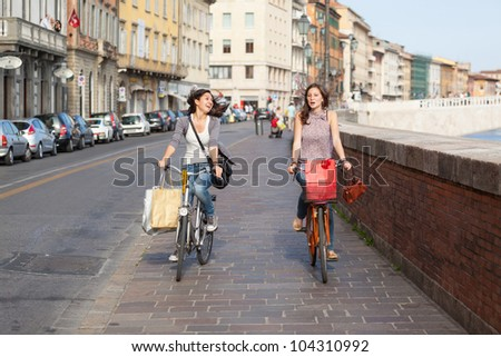 Two Beautiful Women Going by Bicycle
