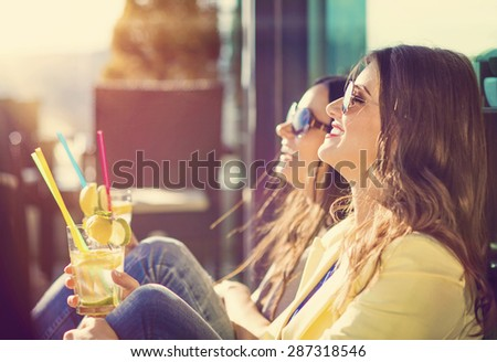Two beautiful women having fun in a bar #287318546