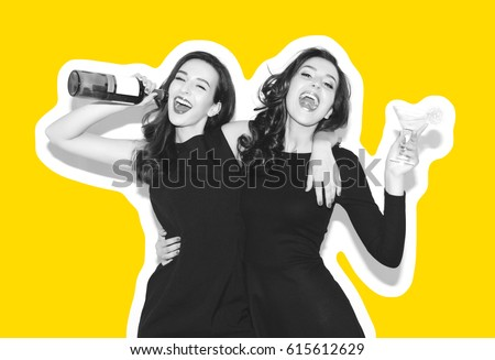 eafee3ba8bd46 Two beautiful women in black night fashion dress posing isolated on a white  gray background.