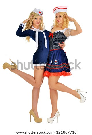 Two beautiful women in carnival sexy  costumes of seaman. Isolated image.