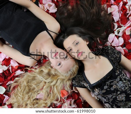 Two beautiful women in rose petals