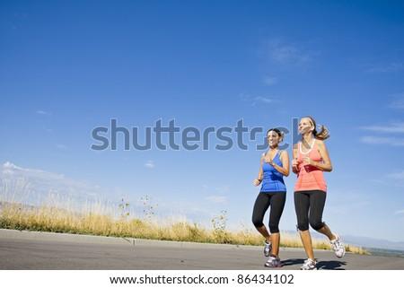 Two beautiful women on morning run outdoors