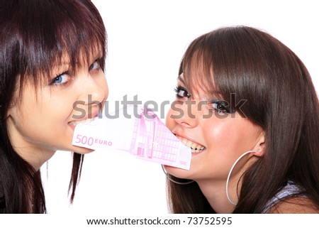 Two beautiful young girls with Euros bill between their teeth
