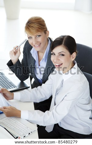 two beautiful young office workers