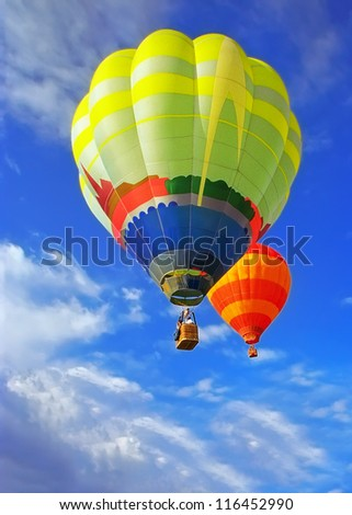 Two beauty balloons flying in sunny blue sky