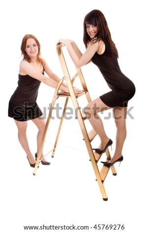 two beauty girls with stepladder - stock photo
