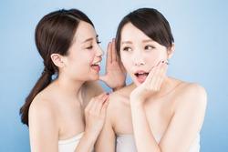 two beauty woman speak something with healthy skin care on the blue background