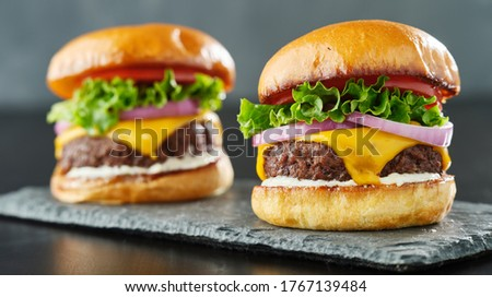 two beefy cheeseburgers with american cheese, lettuce tomato and onion Сток-фото ©