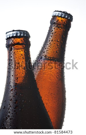 Two beer bottles with dewdrops