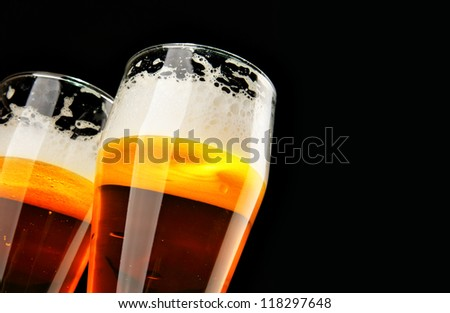 Two beers with froth with copyspace