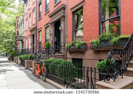 Two bicycles in front of a brownstone building in neighborhood of Brooklyn Heights, New York #1145730986