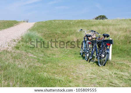 Two bicycles parked in the dunes, the Netherlands.
