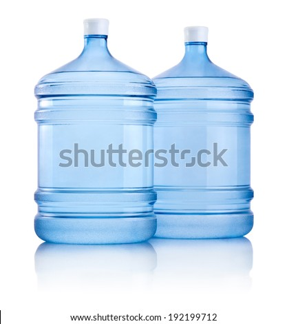 Two big bottles of water isolated on white background
