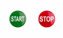 two big green and red buttons with start and stop captions on white isolated top view