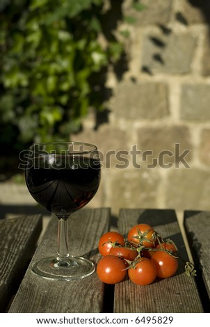 Two big italian products - wine and tomatoes