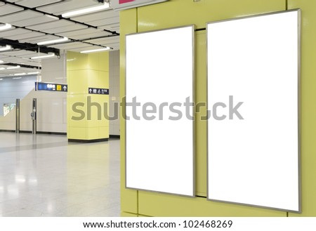 Two big vertical / portrait orientation blank billboard on modern yellow wall with corridor background