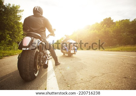 two bikers riding unknown motorbike with blur movement, speed concept #220716238