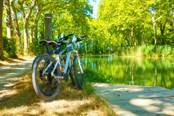 two bikes and river- sport, freedom, tourism concept- Canal du Midi
