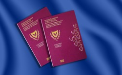 Two biometric Cypriot passports on blue background.