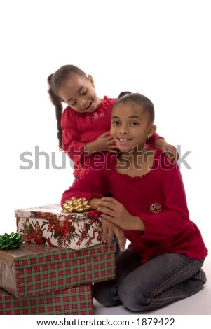 Two Biracial girls posing for a Christmas portrait.