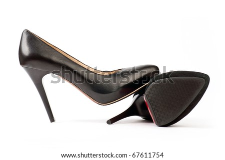 Two black female shoes, suede and leather ones, on the white background