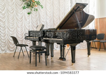 Two black grand pianos on stage. #1094583377