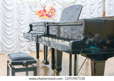 Two black grand pianos on stage. Two grand pianos on stage without no one. #1295907130
