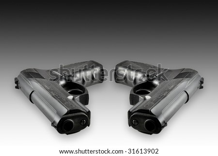 Two black guns isolated on black-white background