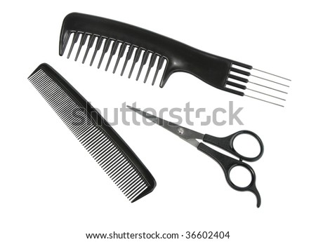 Two black professional combs and scissors. Close-up. Isolated on white background.