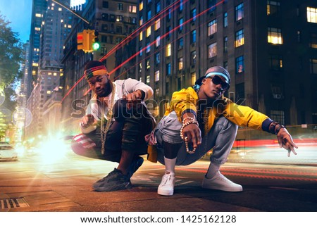 Two black rappers dancing on city street ストックフォト ©