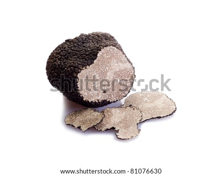 two black truffle on white background