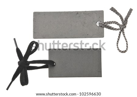 two blank black cardboard paper labels or tag isolated on the white background